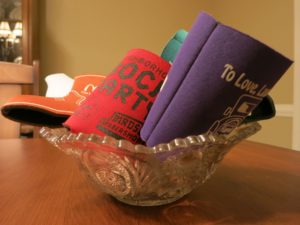 A collection of koozies on koozie guy's table